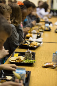 Students eating at a cafeteria table