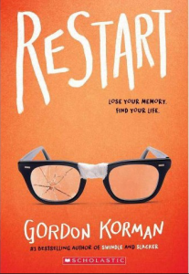 Restart by Gordon Korman book cover. Glasses taped on nose piece and a shattered lens on an orange background.